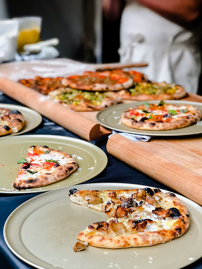 Wood fired pizza display on large cutting boards
