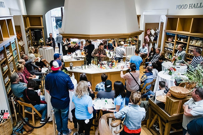 Attendees watch a bartending competition inside the Portland Williams Sonoma