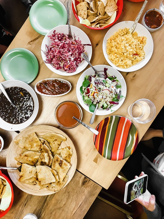 overhead photo of multiple plates of el salvadorian food
