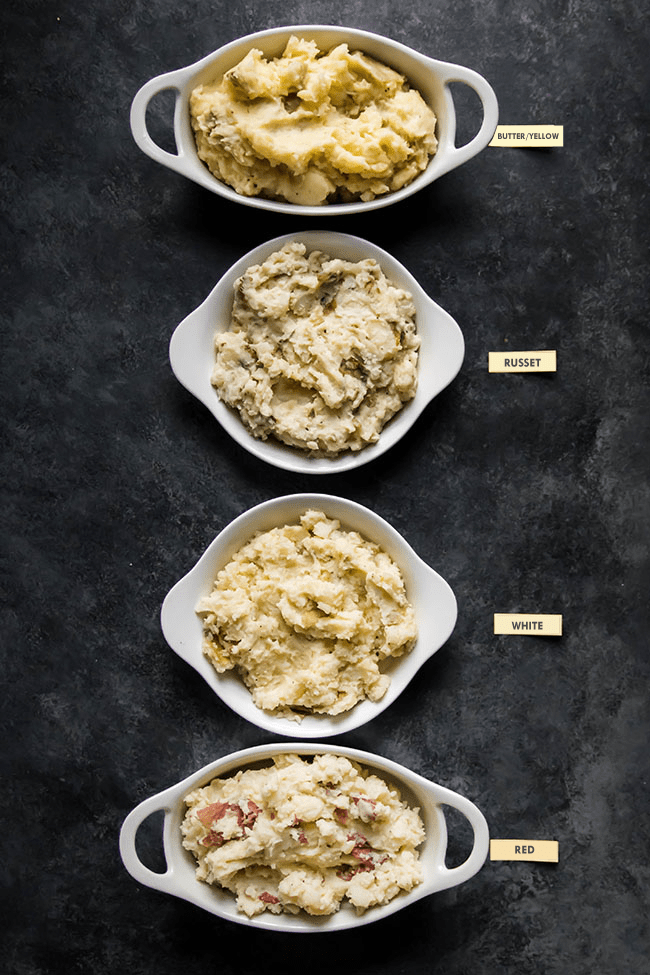 overhead photo of four white dishes filled with mashed potatoes on a black background