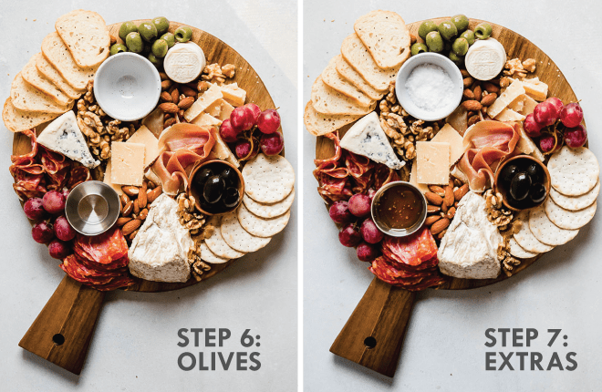 Adding honey, olives, and flakey salt to a cheese board. Grey text overlay reads \'step 6: olives, step 7: extras.\'
