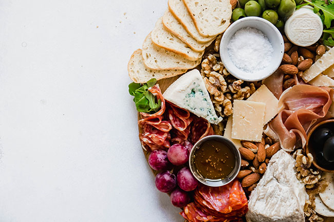 An off-center cheese board on a white background.