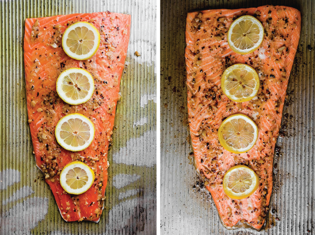 Steelhead fillet topped with four lemon slices on a baking sheet.