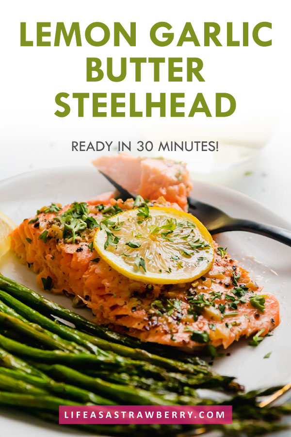 """photo of steelhead trout on a white plate with text overlay that reads """"lemon garlic butter steelhead"""""""