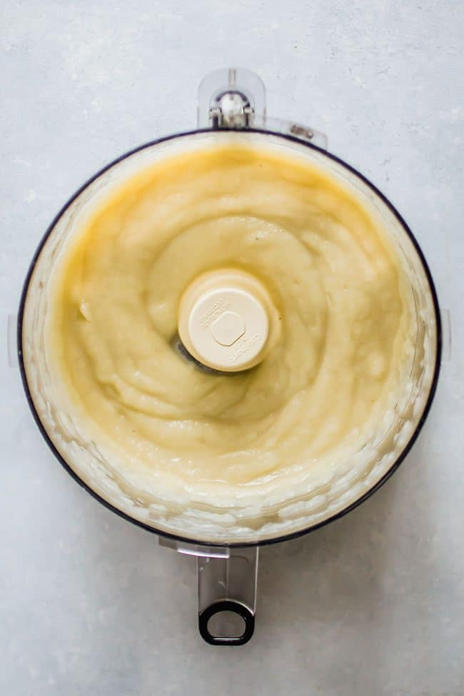 overhead photo of cauliflower puree in a food processor.