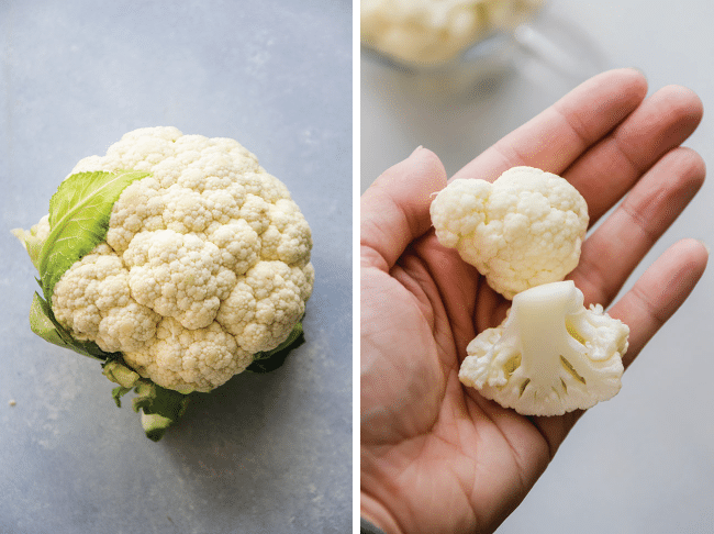 woman's hand holding cauliflower florets