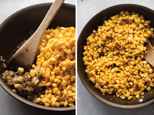 Wooden spoon stirring corn and onions in a skillet