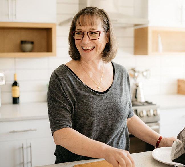 Rhonda standing in a bright kitchen.