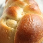 Close up of the challah loaf's braid pattern.