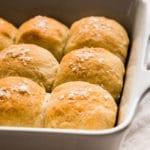 Fresh dinner rolls in a white casserole dish