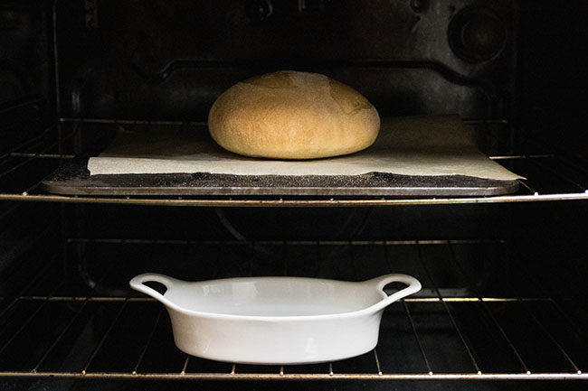 Crusty bread on a baking steel in the oven.