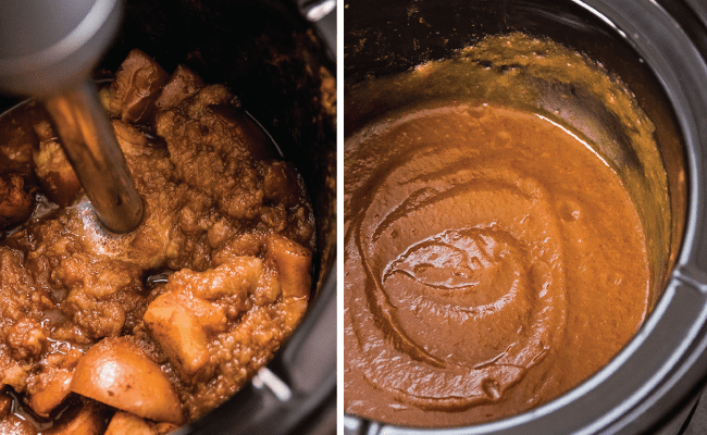 Silver immersion blender blending cooked apples into apple butter in a black slow cooker bowl