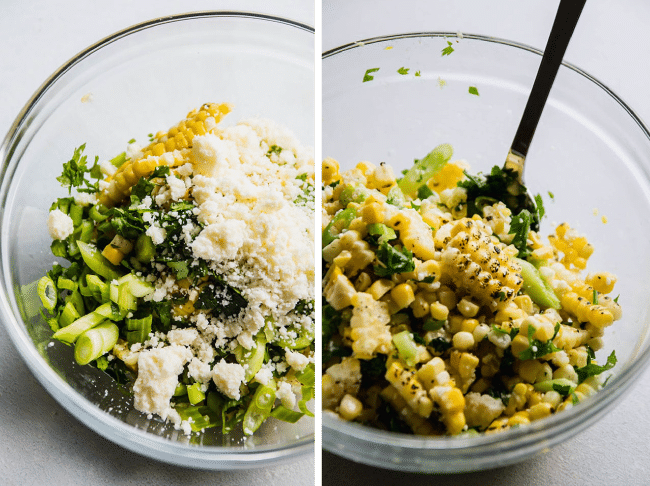 Spoon stirring grilled corn, cilantro, and green onions together in a glass mixing bowl.
