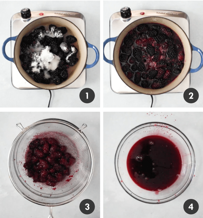 Blackberries and sugar in a small pot, being cooked down into a thick syrup.