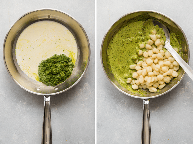 Gnocchi, pesto, and heavy cream being stirred together in a skillet.