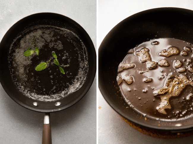 Browned butter with fresh sage leaves in a dark saucepan.