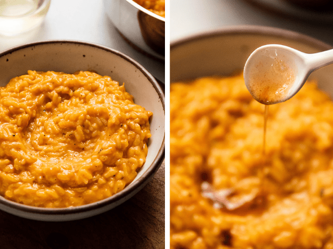 White ceramic spoon drizzling browned butter over butternut squash risotto in a speckled white bowl