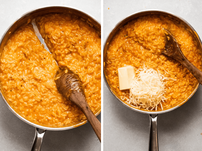 Wooden spoon stirring butter and parmesan cheese into a wide silver skillet full of orange butternut squash risotto.