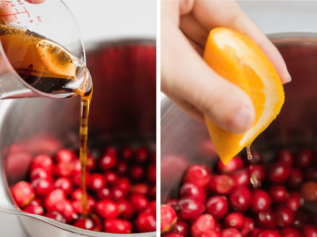 Woman\'s hand pouring maple syrup and orange juice into a saucepan filled with cranberries.