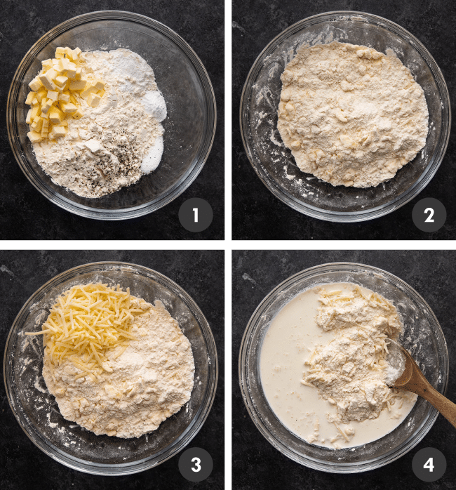 Mixing biscuit ingredients together in a glass bowl on a dark table.
