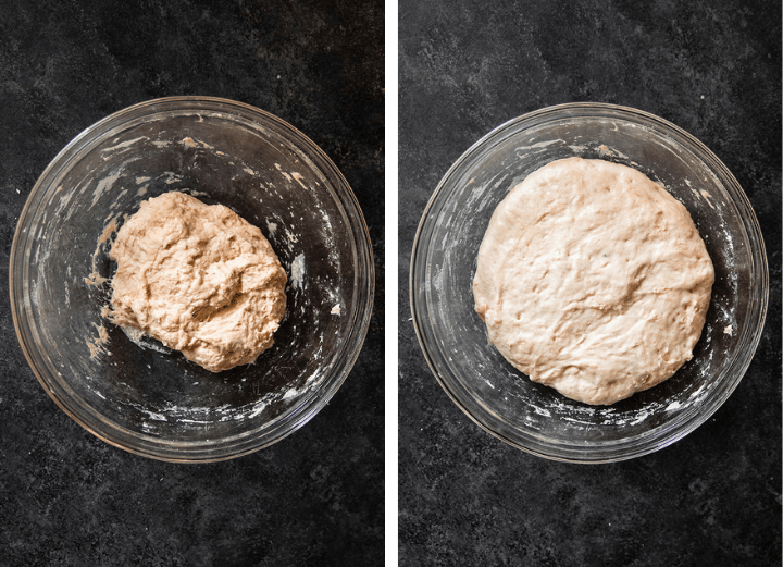Bread dough in a glass bowl on a dark table.