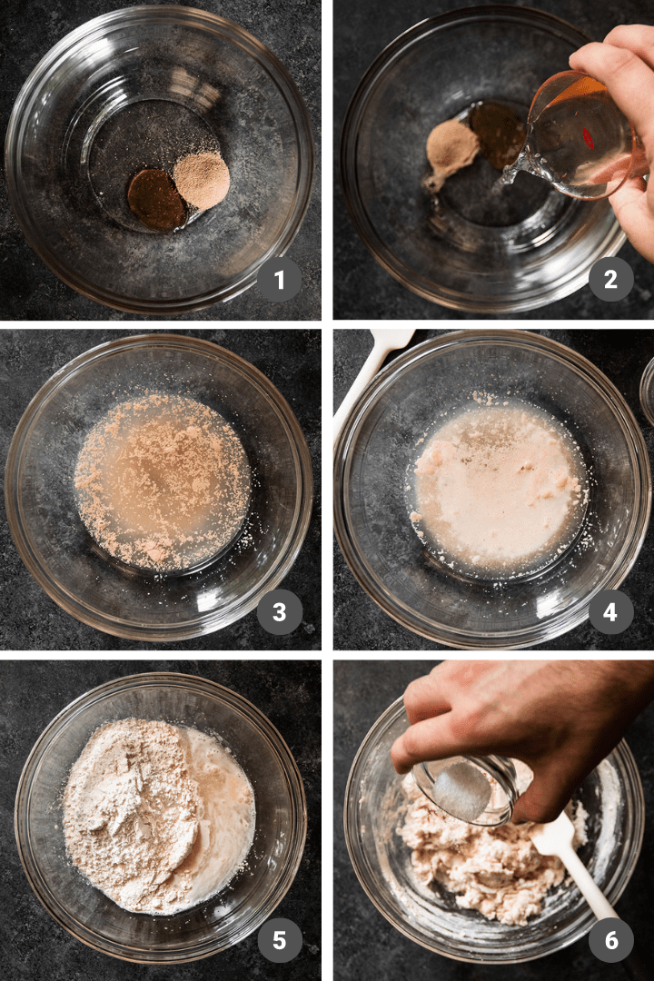 Mixing bread dough in a glass bowl on a dark table.