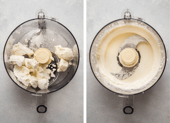 Whipped goat cheese in the bowl of a food processor.