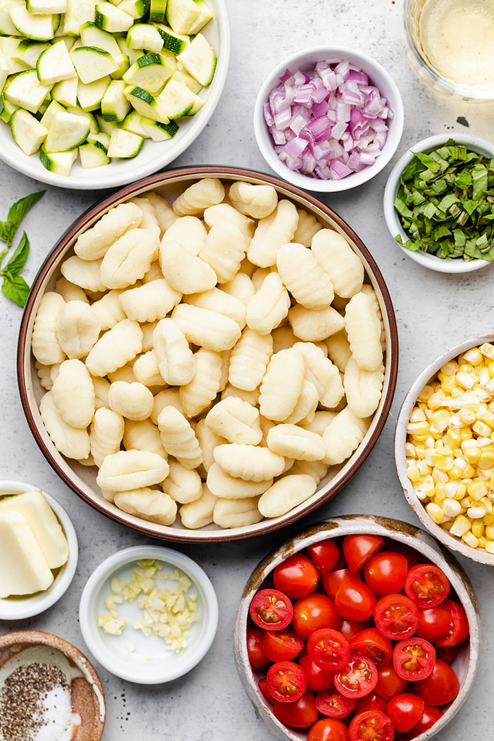Gnocchi ingredients, organized into individual prep bowls on a white table.