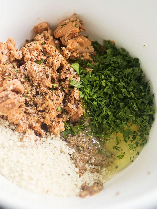 Salmon patty ingredients in a white mixing bowl.