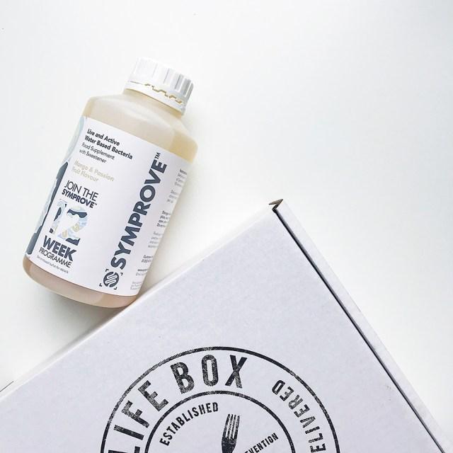 Lifebox vegan gluten free snacks with bottle of Symprove