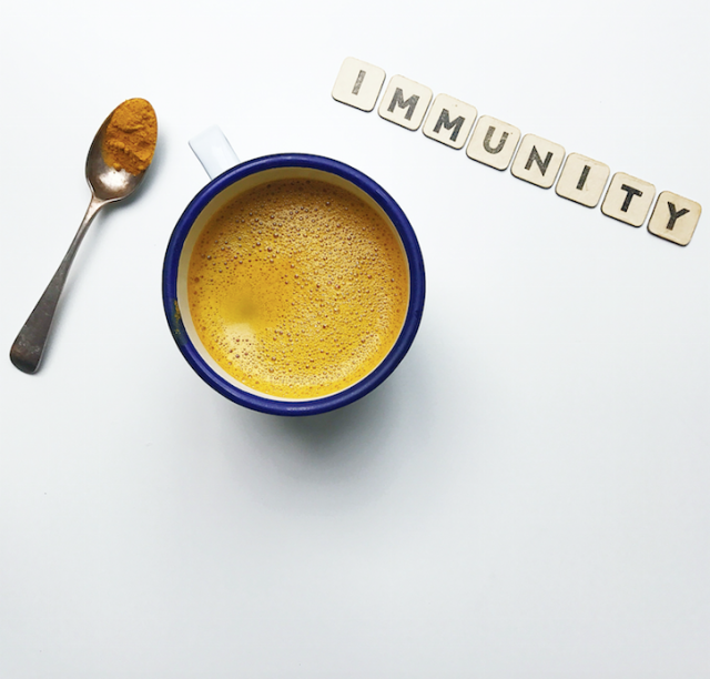 Cup of coffee with immunity letter blocks