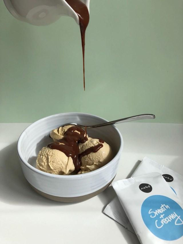 nobo chocolate sauce poured over ice cream