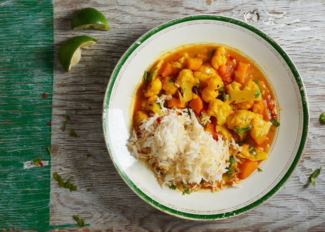Top down of vegetable curry with limes