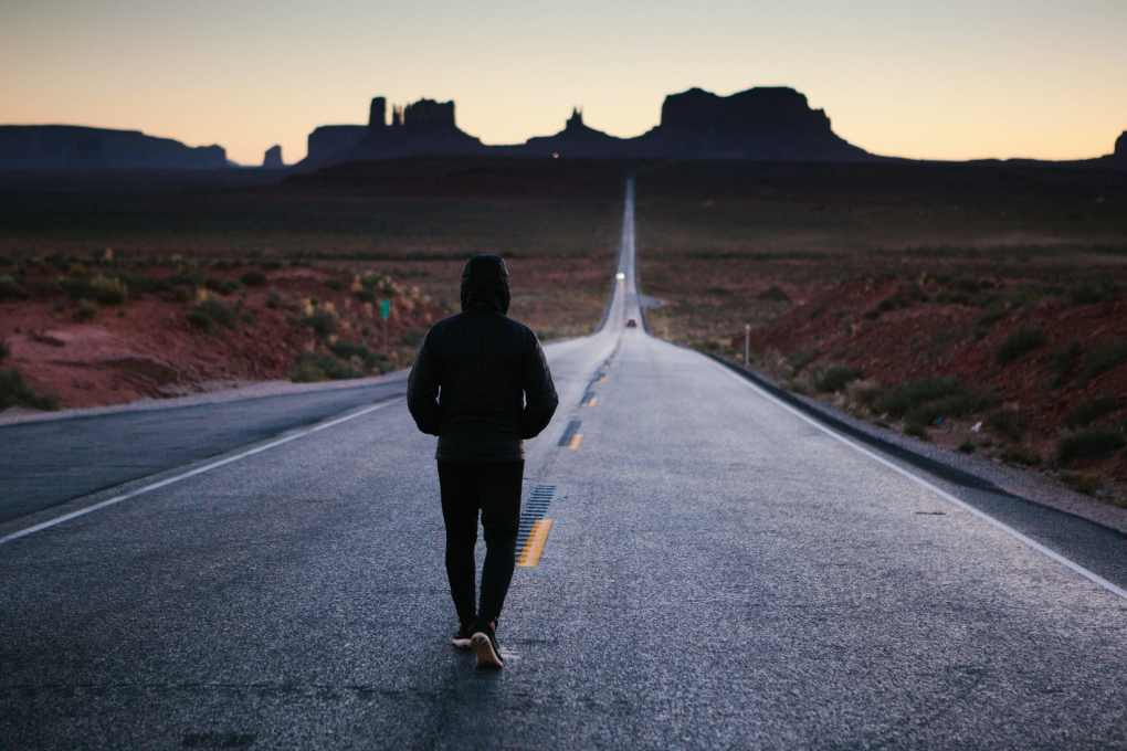 Man walking a long road