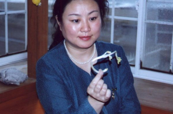 Chinese-woman-psychic-growing-plant-seed