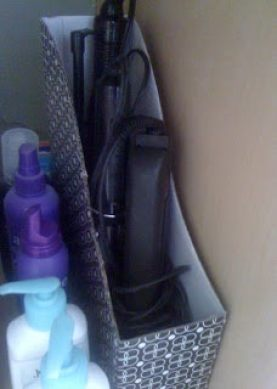 Bathroom storage - use a magazine box to keep hair dryer and flat irons neat under the sink.