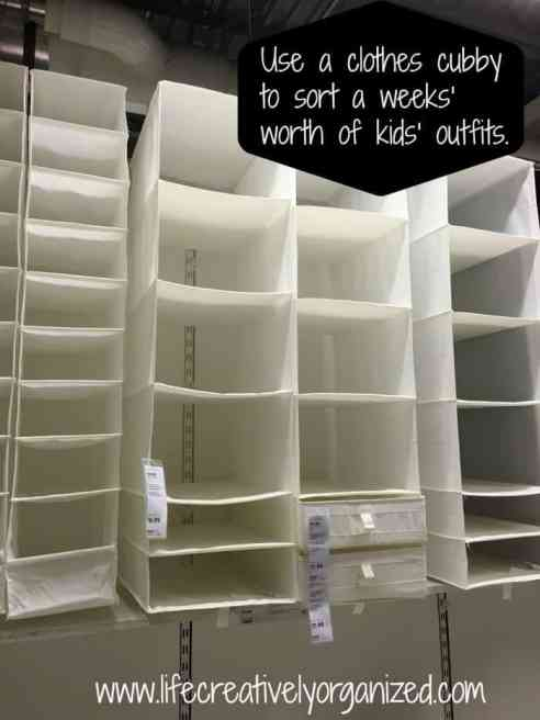 Organize kids' clothes - Use a hanging clothes cubby to sort a weeks' worth of kids' outfits for less stress in the morning!