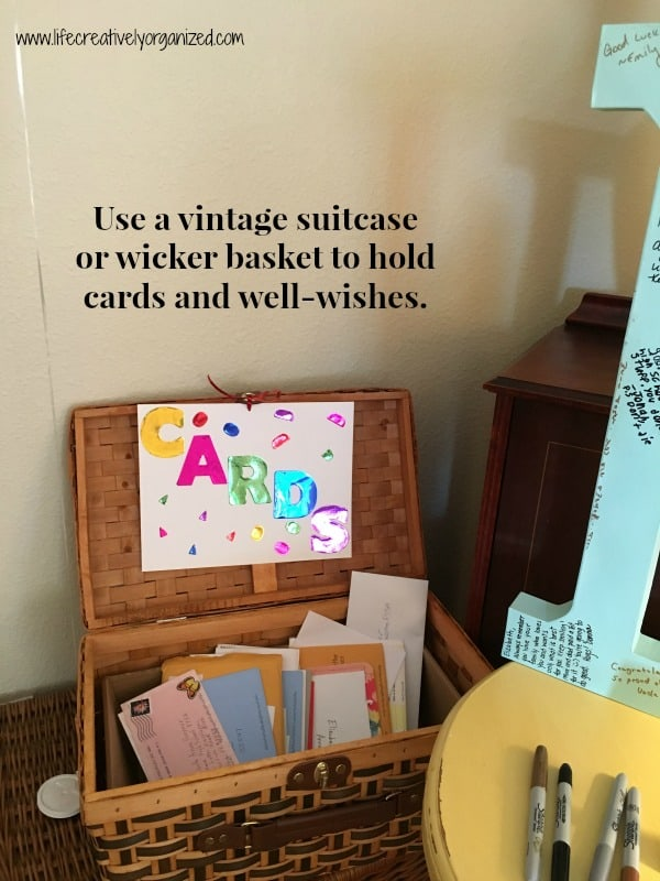 Graduation party decorations - provide a vintage suitcase or wicker basket card basket to hold cards and well wishes.
