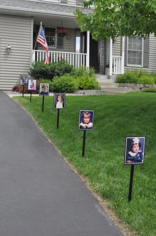Graduation party decorations - Line the party site driveway with pictures of the graduate from babyhood through high school. Your grad may be embarrassed, but the guests will love it.