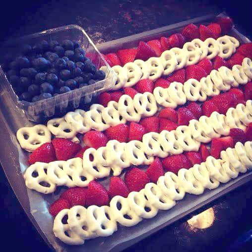 Patriotic food. Strawberries, blueberries and yogurt-dipped pretzels make a patriotic flag of yumminess!