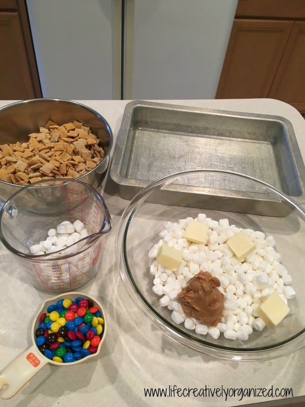 Measure out ingredients for clingons - an easy dessert made with cereal.
