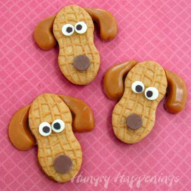 10 fun school snacks. Peanut butter puppies made from Nutter butters, white and chocolate chips and caramels! How cute!!!