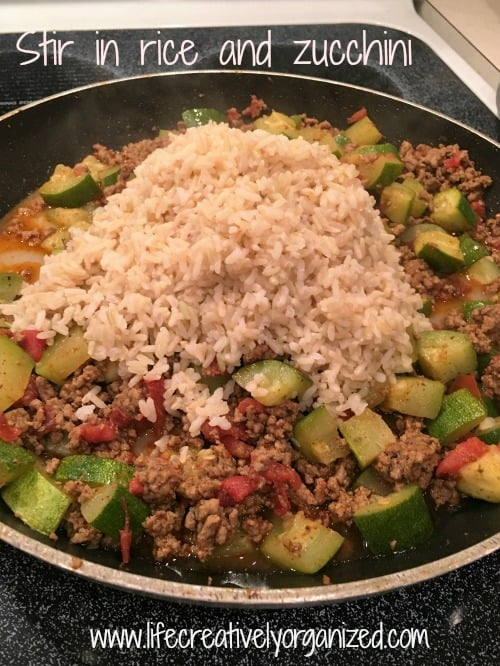 Easy skillet spicy veggie, beef and rice? Yes, please! A filling, easy one-skillet meal the whole family will love, and clean up is a breeze!