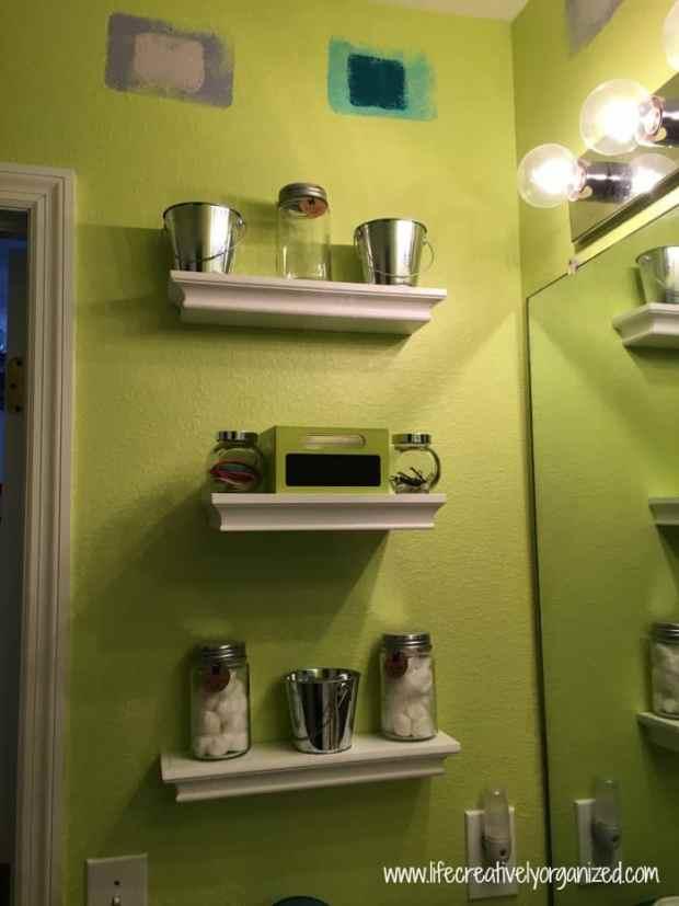 Kids' bathroom makeover - adding shelving to bathroom wall.