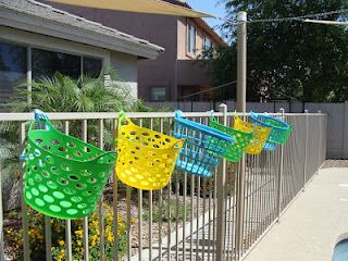 Awesome Pool Storage Ideas   Baskets Hung On Fence