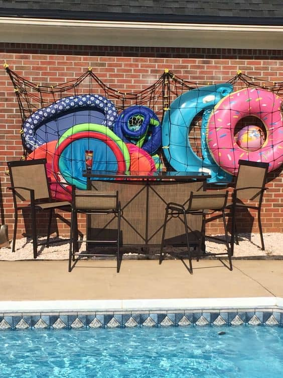 Pool Towel Rack Ideas pool towel rack made this with 4x4 post post cap ladder hangers and Awesome Pool Storage Ideas Pool Toy Holder Made From Cargo Net And Command Hooks