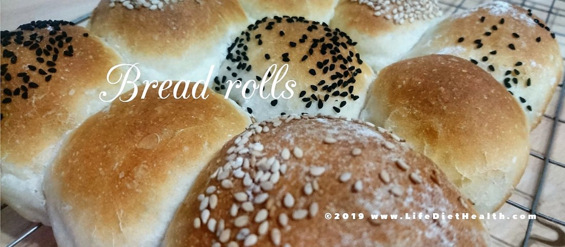 Bread rolls with seeded toppings, freshly baked and still joined together