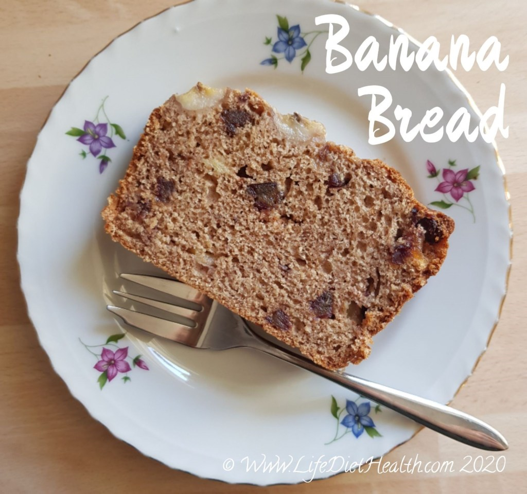 Slice of banana bread on a flower patterned gold rimmed cake plate with a cake fork.