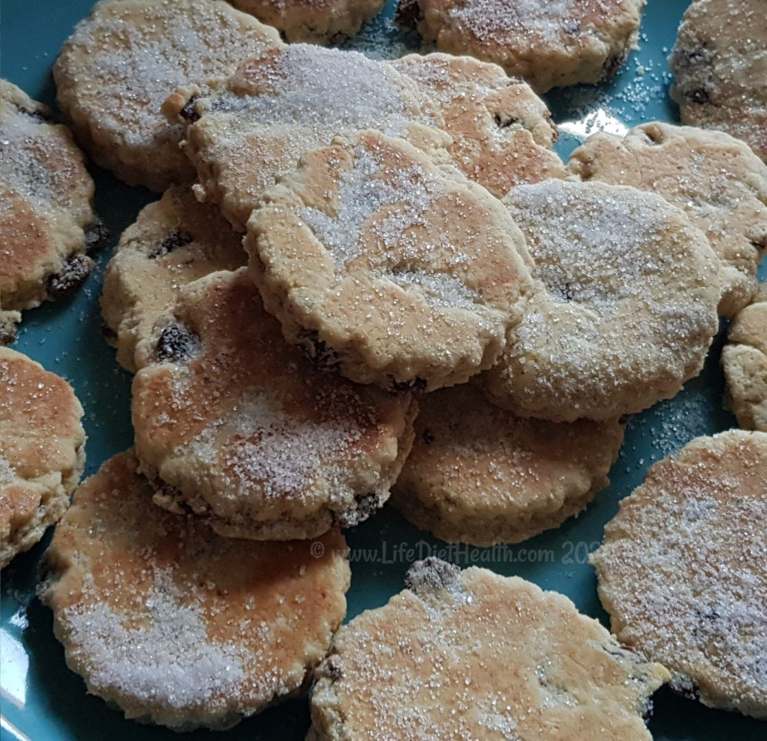 Freshly made Welsh cakes stacked on a plate