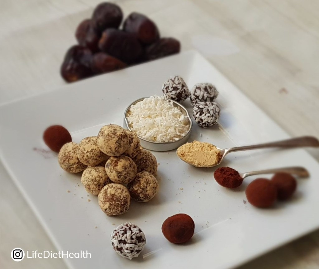 Plate of various energy balls and ingredients